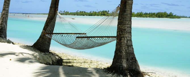 Hammock strung between two palms, Cook Islands